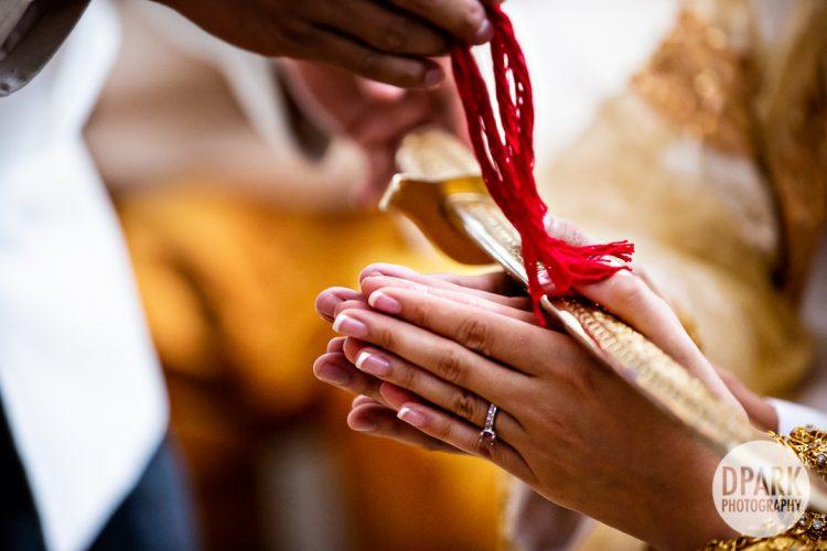 knot-tying-cambodian-wedding-ceremony-photographer